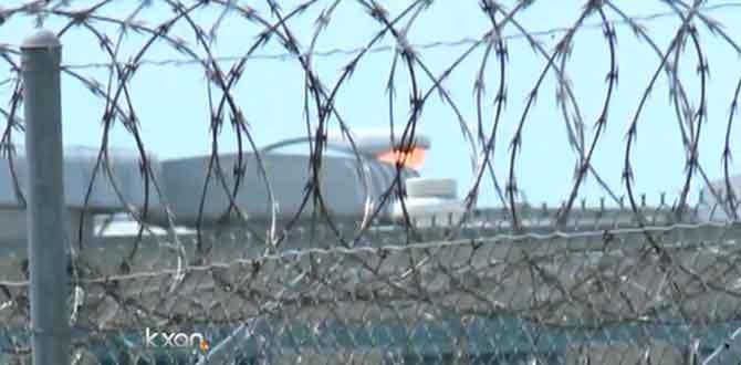 Jail prison barbed wire_116369