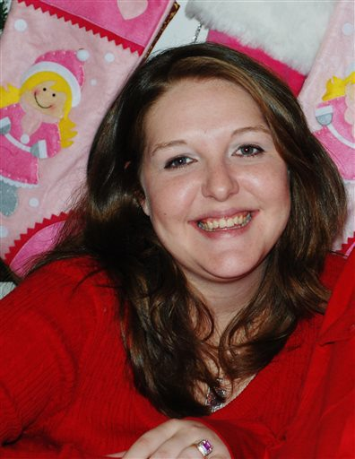 This 2009 photo provided by the Hunt family shows Kari Hunt Dunn. Hunt's 9-year-old daughter tried to call 911 from the hotel room where she could hear her mother dying but didn't know to dial 9 first. (AP Photo/Courtesy of the Hunt family)