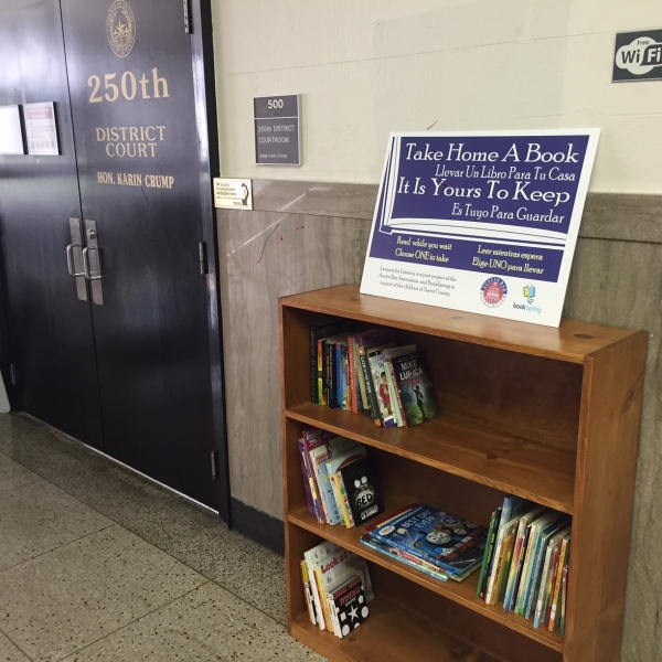 A bookshelf at Travis County Courthouse offers free reading for children accompanying their parents to court_285966