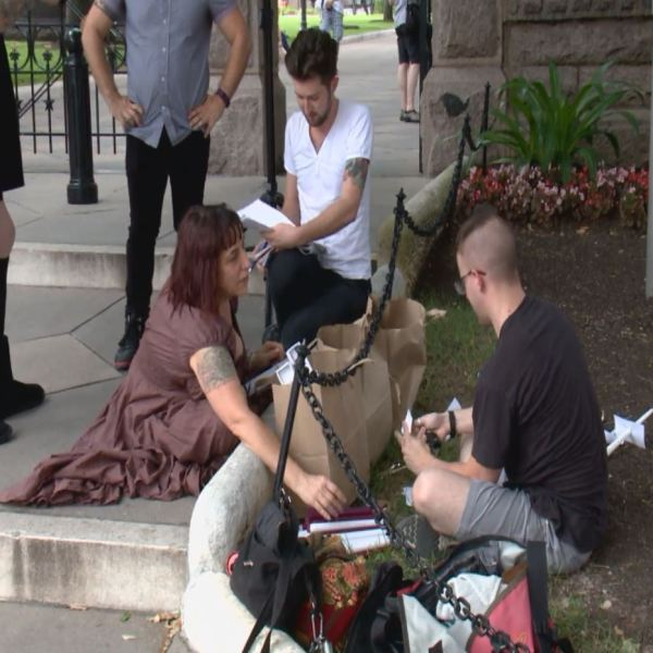Organizers at the Capitol prepare for a vigil honoring the victims of the Orlando shooting on June 12, 2016._298226
