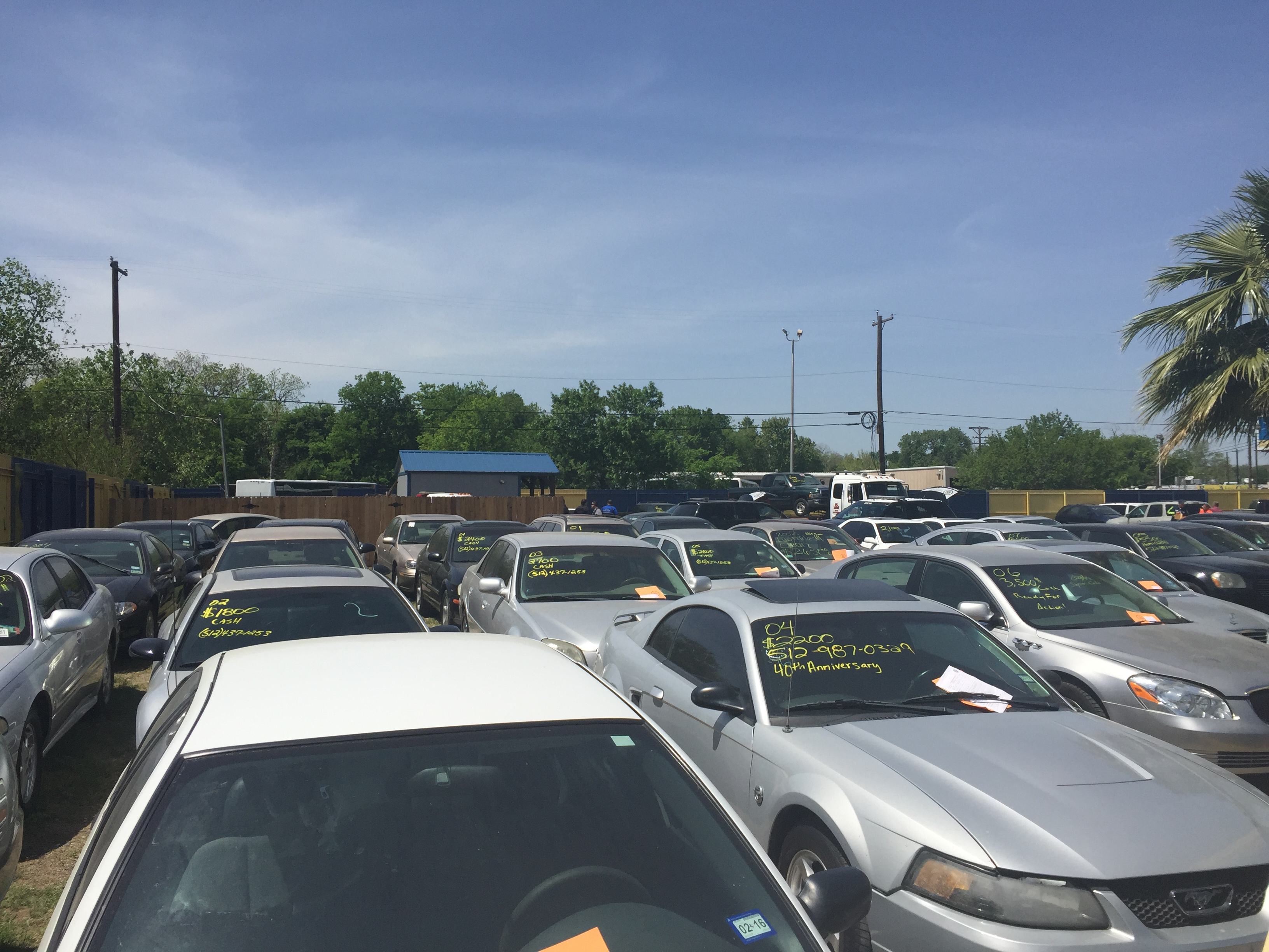 Discount Auto Sales, located at Airport Boulevard and Springdale Road, was shut down by the city on April 6, 2016. (KXAN Photo/Amanda Brandeis)