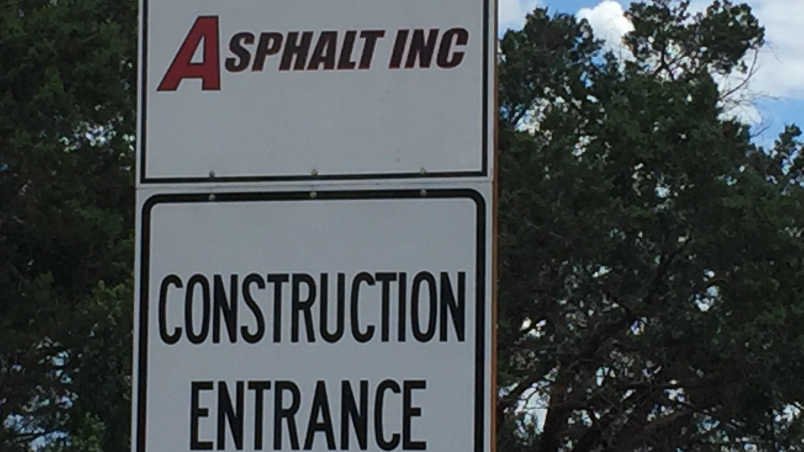 Exterior sign at Asphalt Inc., a hot-mix asphalt plant in Spicewood, Burnet County._295749