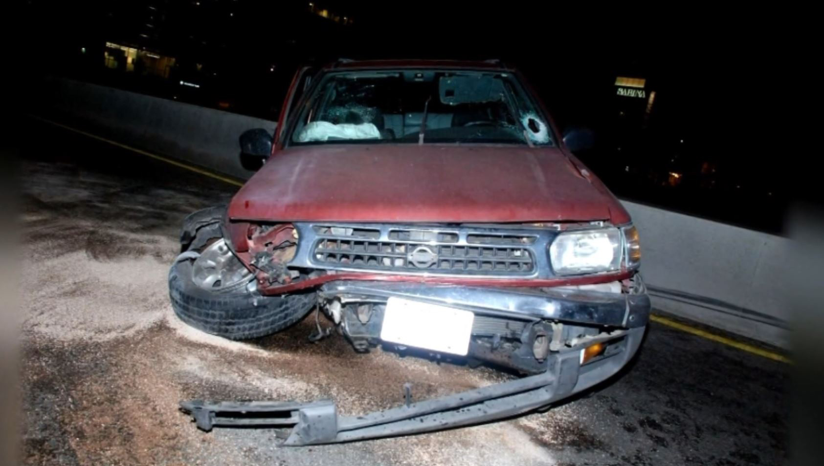 Damage done to Kenneth Johnson's SUV the night of the rock attack on June 14, 2014. (APD)