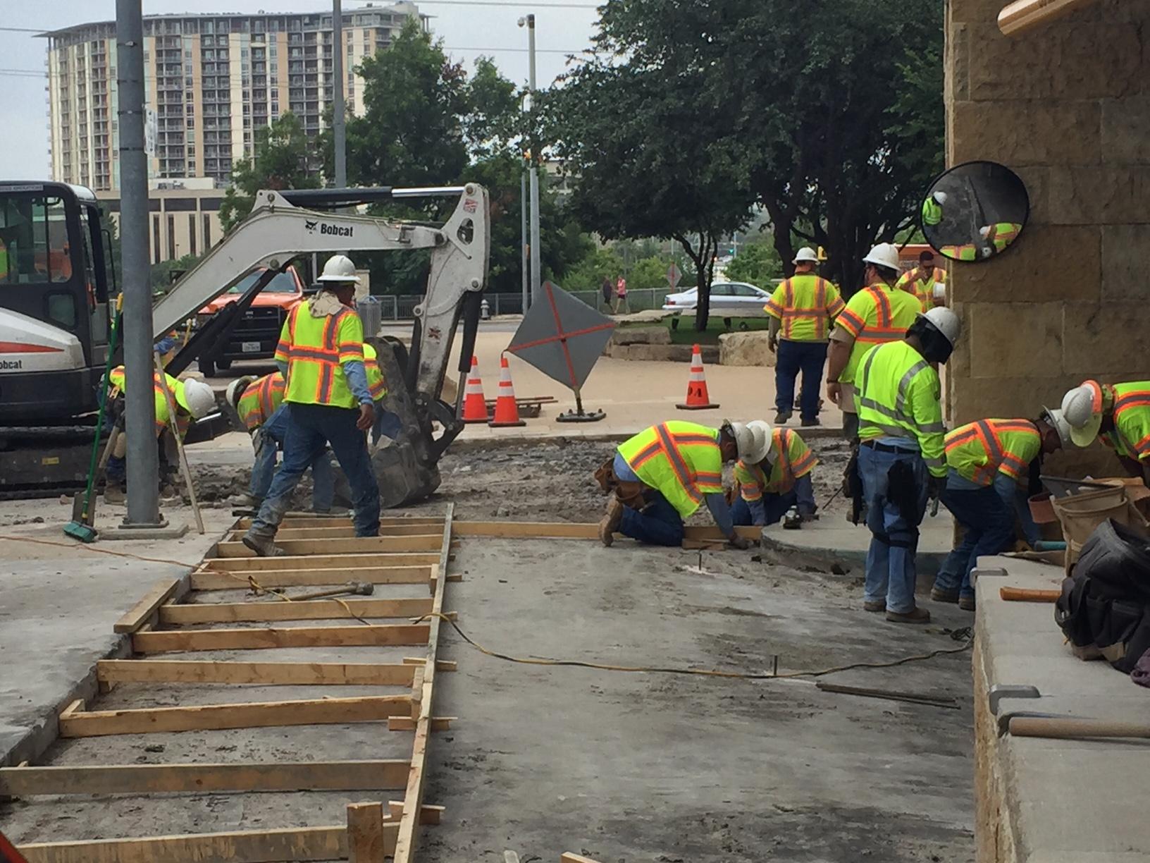 Construction began on the City Hall driveways Sunday, July 10, 2016._310247