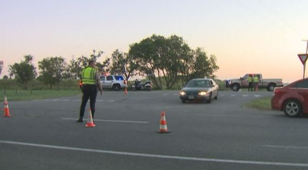Police direct traffic at the scene of a deadly crash involving a semi on SH 71 westbound near Wolf Lane_323312