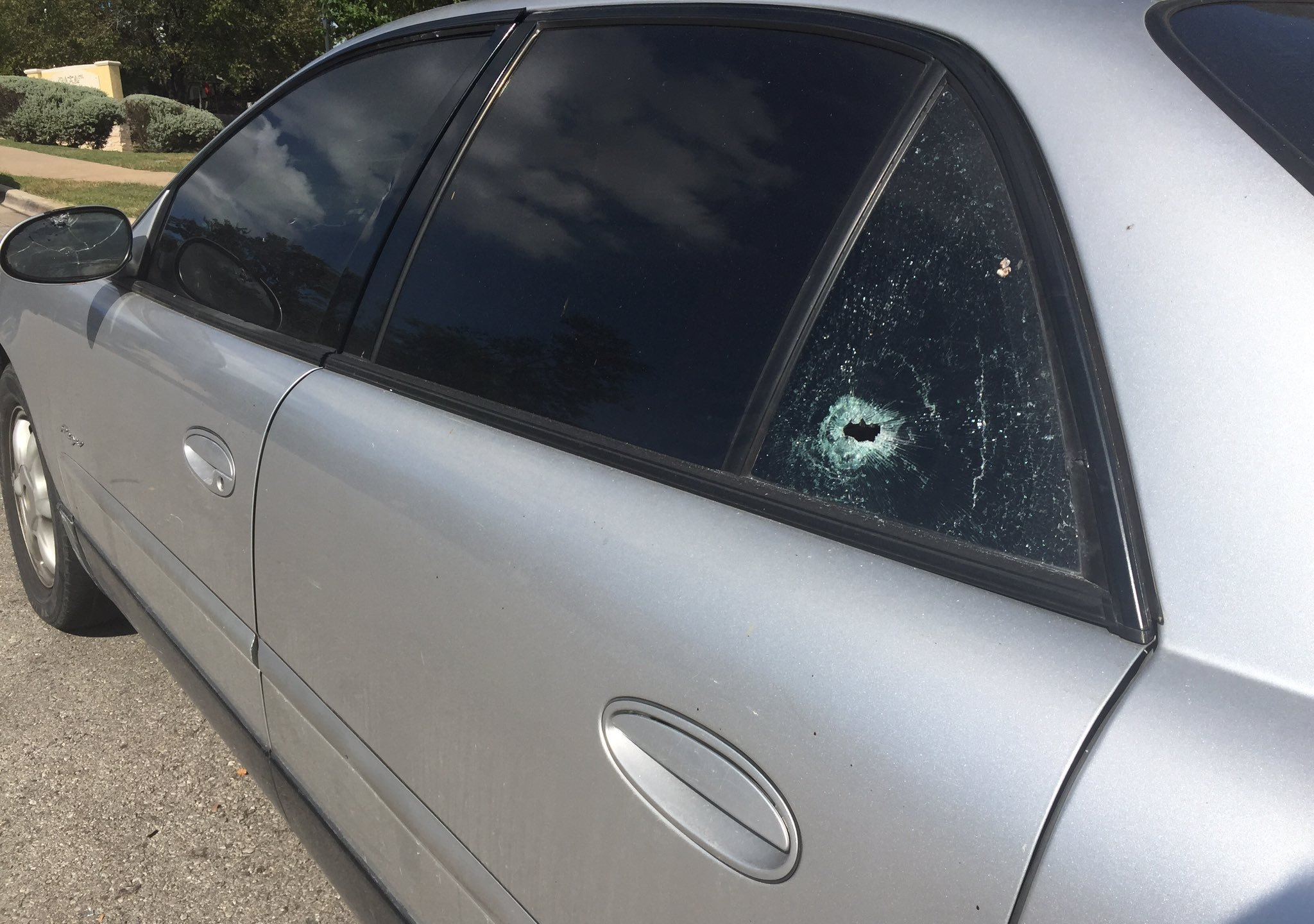 A car hit during a shooting in the 5900 block of E. Stassney Lane that left a teenager injured. Sept. 22, 2016_351637