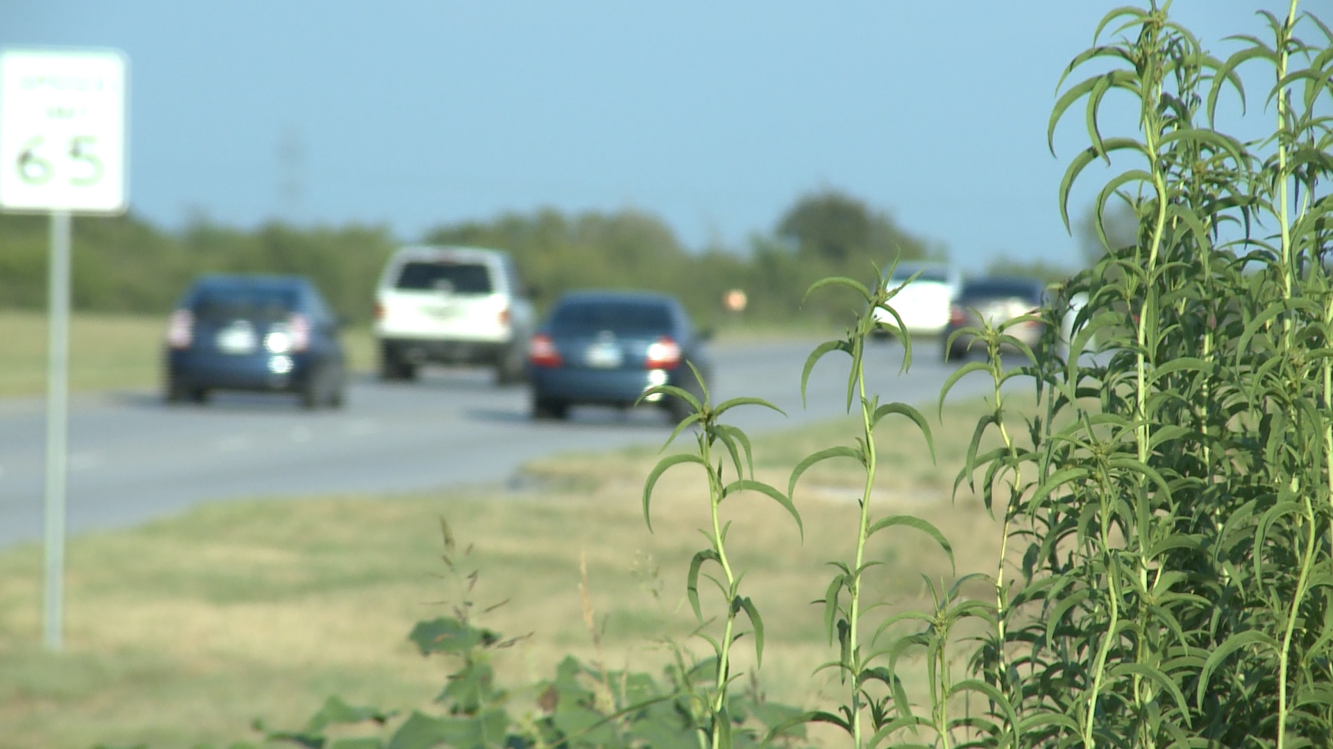 Cars drive along Parmer Lane in between in the urban-rural interface._346971