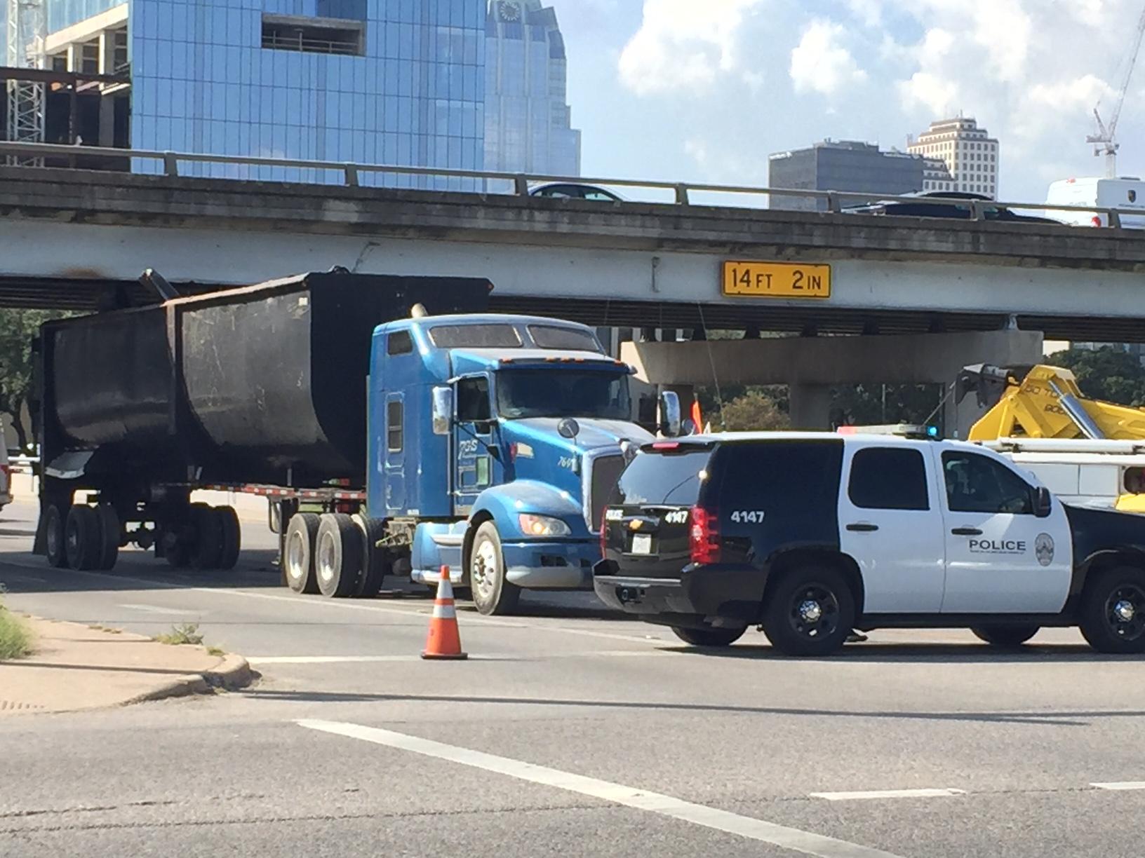 An 18-wheeler stuck under an I-35 bridge at Cesar Chavez Street._350541