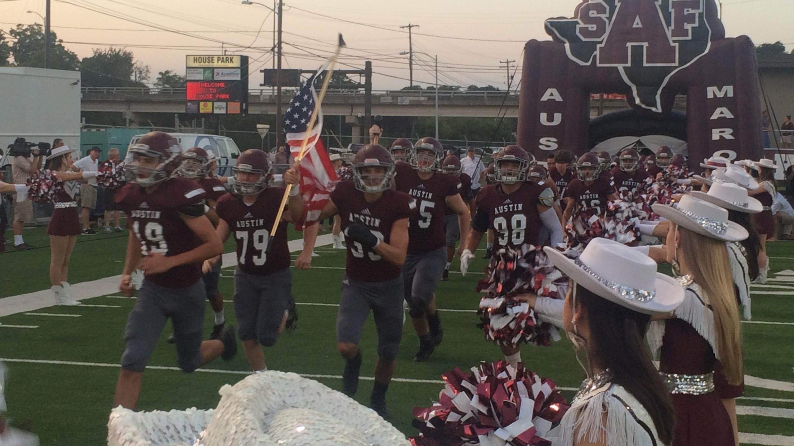 Austin High School Football team entering_349202