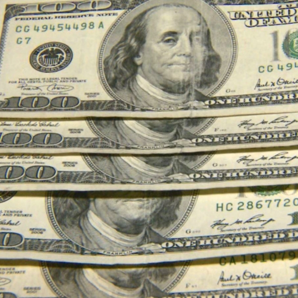 FILE - Money, hundred dollar bills_366697
