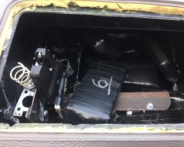 An elaborately designed compartment stored $50,000 in laundered money. The money was found by Sgt. Thumann and K9 Lobos of the Fayette County S_370278