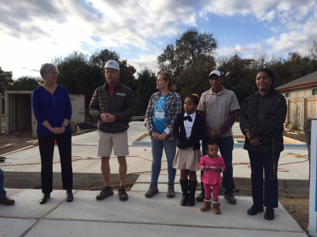 """Volunteers from HomeAway and the Austin Board of REALTORS Foundation """"raised the walls"""" on two affordable homes in Southeast Austin as part of the Holidays """"Blitz Build."""" (KXAN Photo/Dani Guerrero)"""