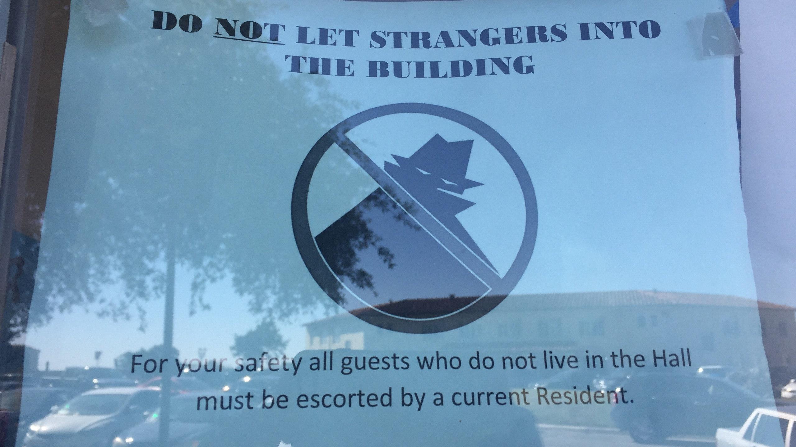 Signs posted on the entrance to Smith Hall at Texas State University after a student was assaulted by 5 men_380944