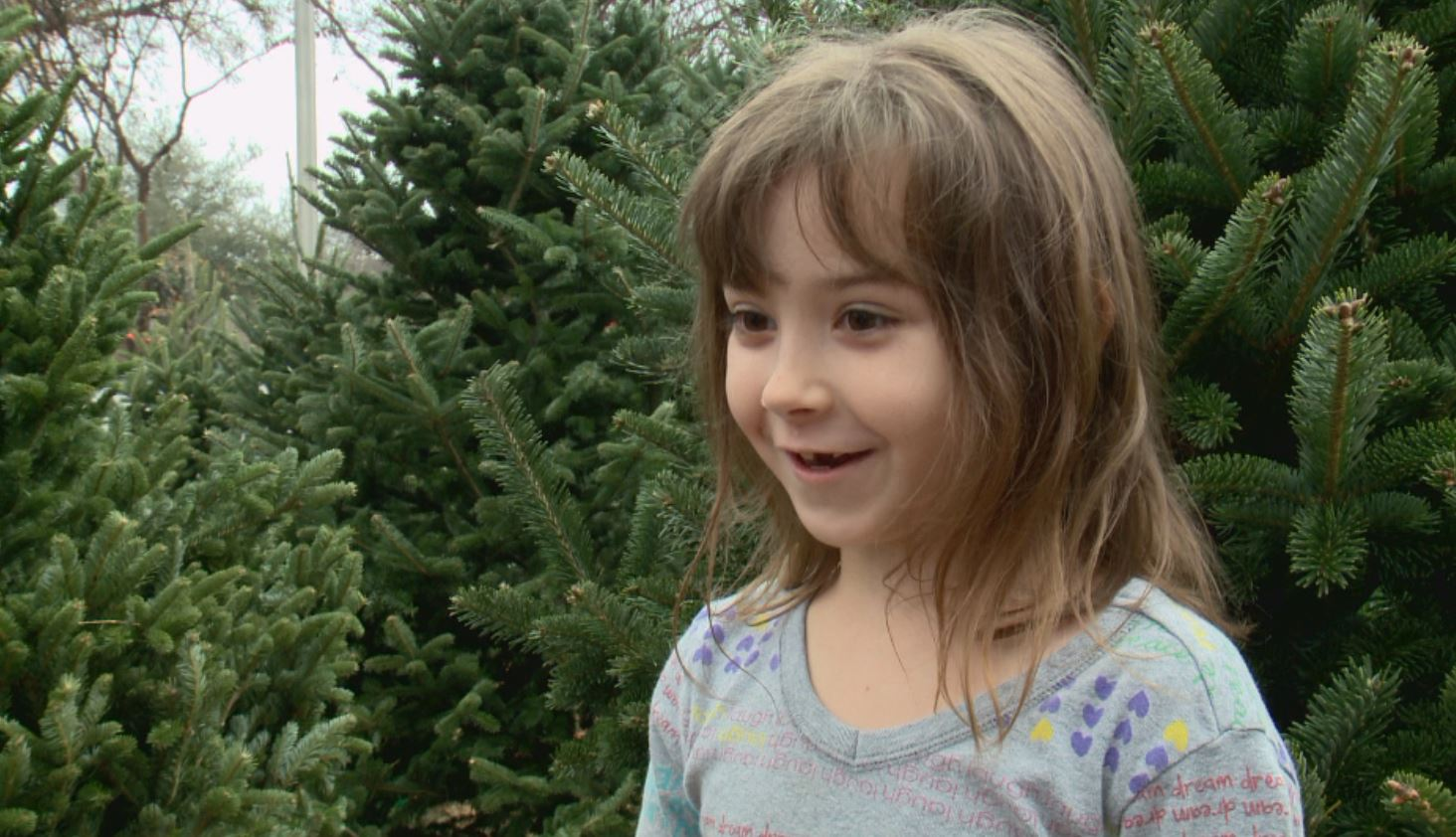 "Alex Shelton, 7, is a ""big fan of Christmas."" (KXAN Photo/Todd Bailey)"