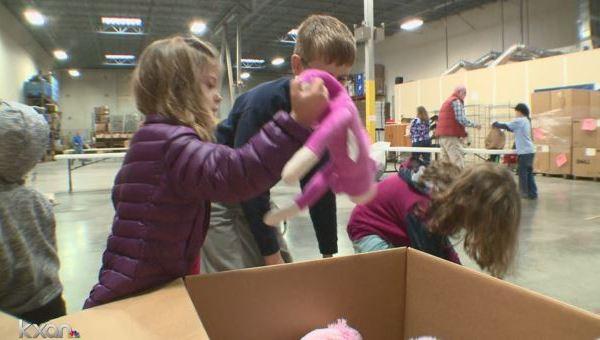 Kids unpack toys at Operation Blue Santa_384622