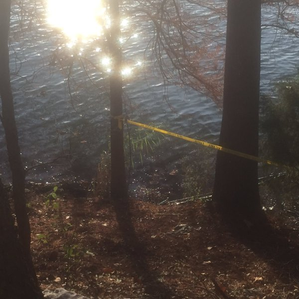 Police tape cordons off the shore of Lady Bird Lake near I-35 where a man's body was recovered on Dec. 28, 2016_393000