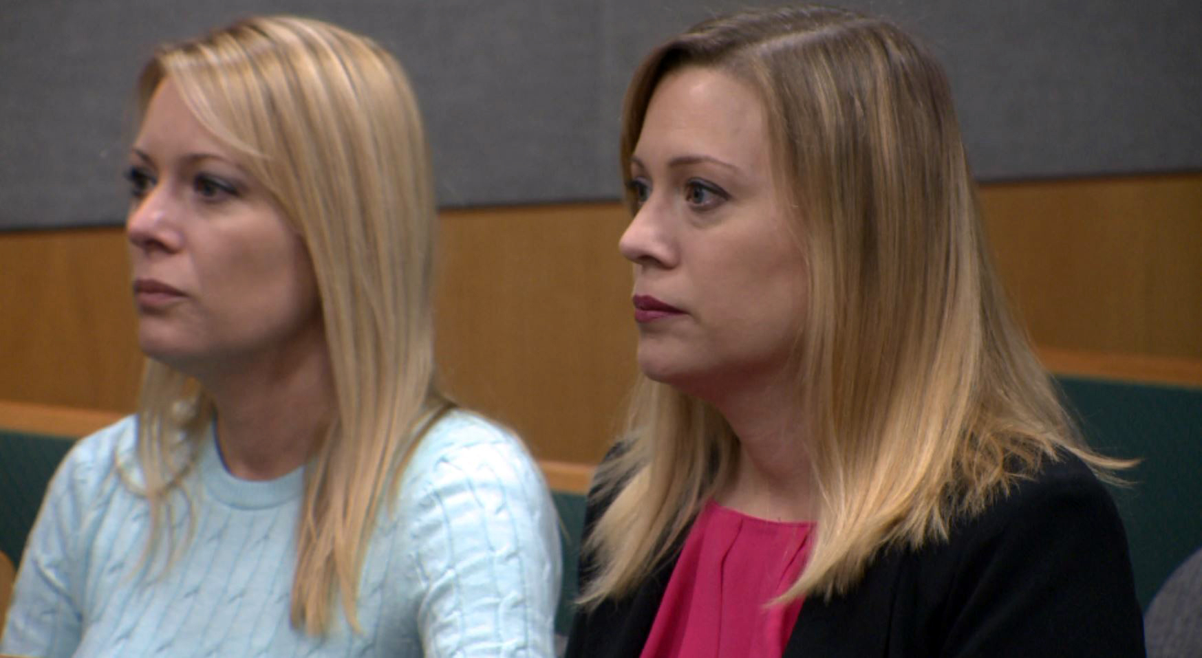 Melissa Marshall, right, gets support from her twin sister in court on Dec. 20, 2016. (KXAN Photo/Tom Rapp)