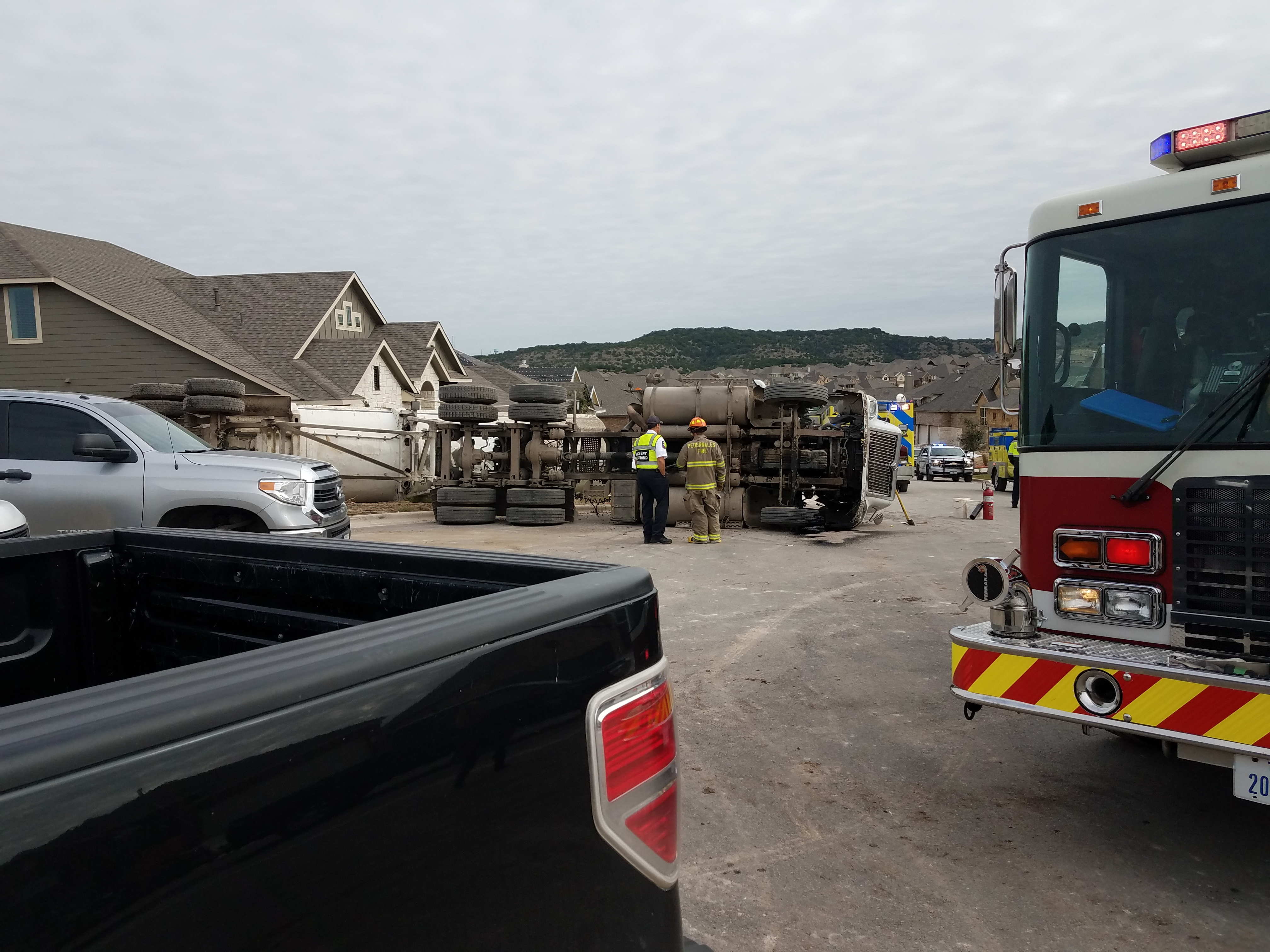 A man died after a dump truck tipped over crushing him on McKay Cove in the Sweetwater subdivision on Dec. 9, 2016. (ReportIt: Cory Armer)