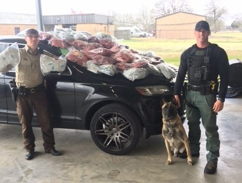Deputy David Smith and K9 Lobos with his partner Randy Thumann, at right, following the discovery of 100 pounds of synthetic marijuana during t_398366