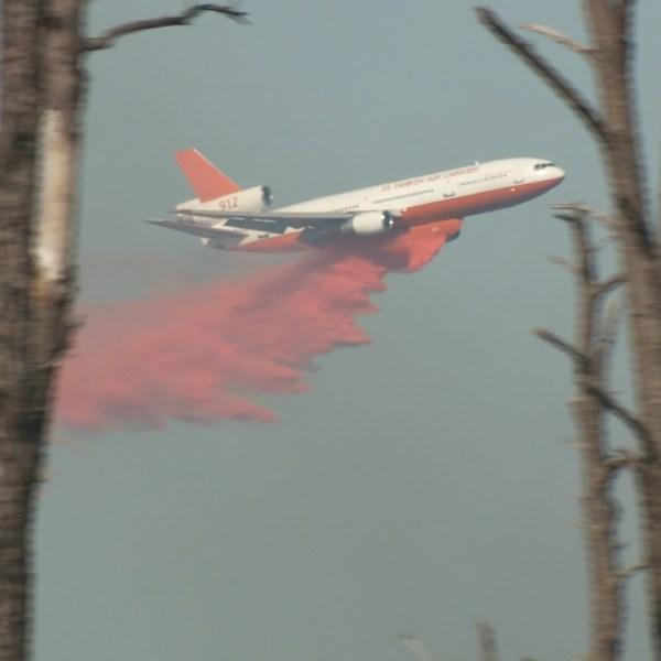 DC-10 tanker dropping retardant on Hidden Pines Fire_188196