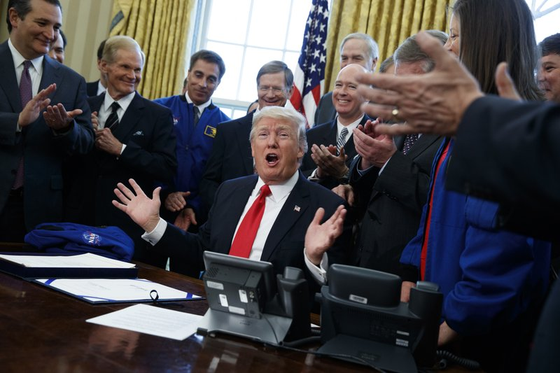 President Donald Trump speaks in the Oval Office of the White House in Washington, Tuesday, March 21, 2017, after signing a bill to increase NA_439845