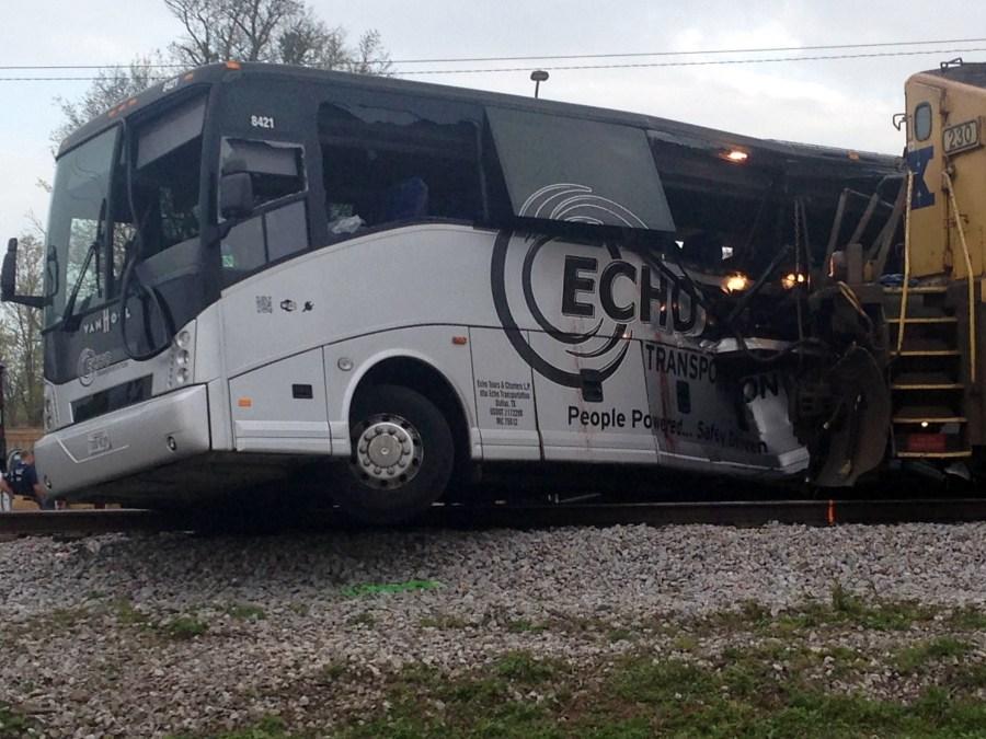 Passenger Says Train Just Kept Coming Toward Bus On Tracks