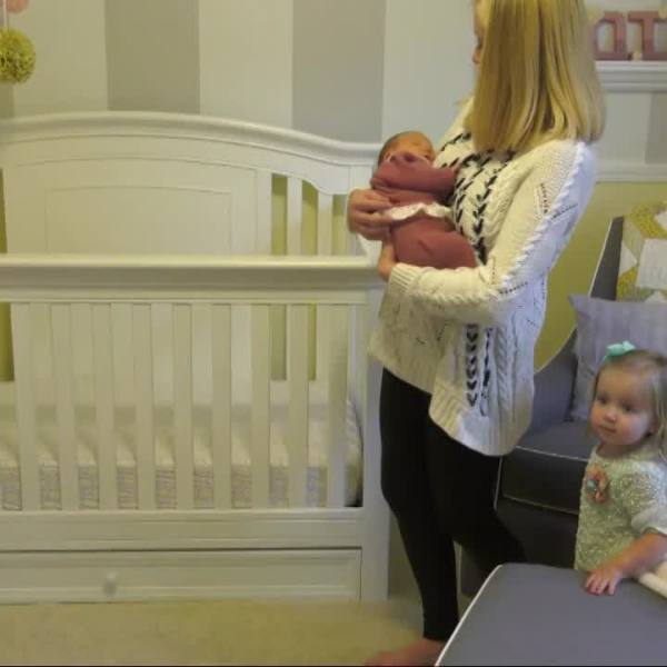 Mother, baby and crib (NBC News file photo)_435141