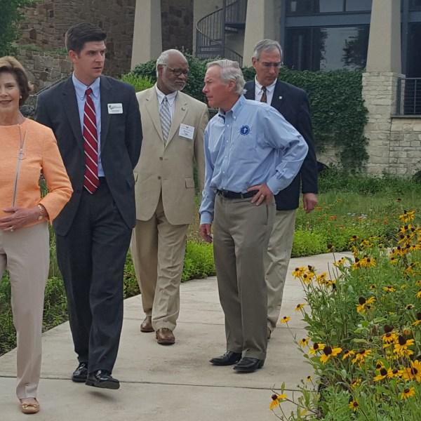 Laura Bush walks through flower garden at the Lady Bird Johnson Wildflower Center. (KXAN Photo_Natalie Ferrari)_481298