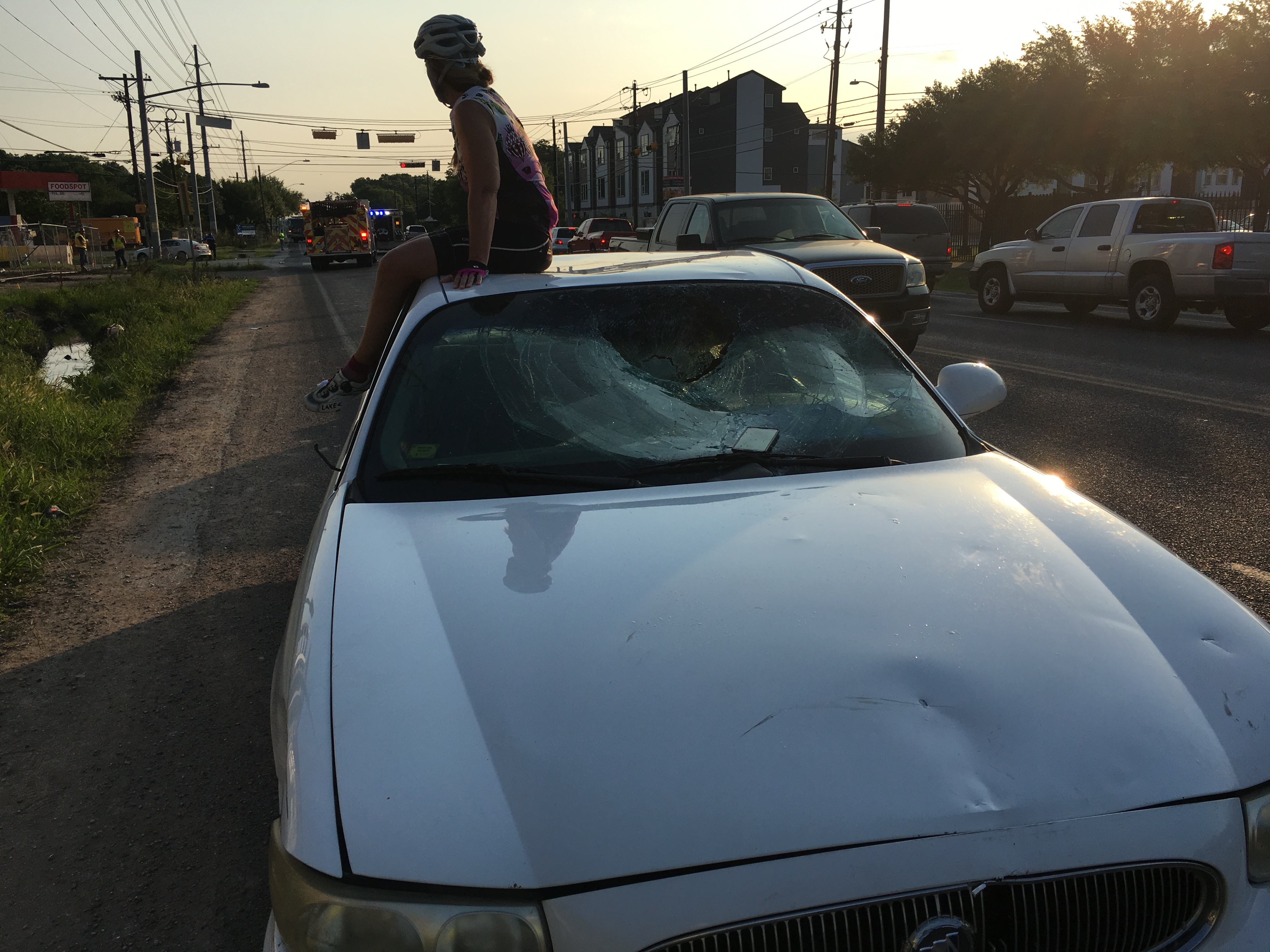 A bicyclist sitting on top of the vehicle that hit four bicyclists on South Pleasant Valley Road and Elmont Drive on Saturday, June 10, 2017. (Courtesy: Wendy Meyer)