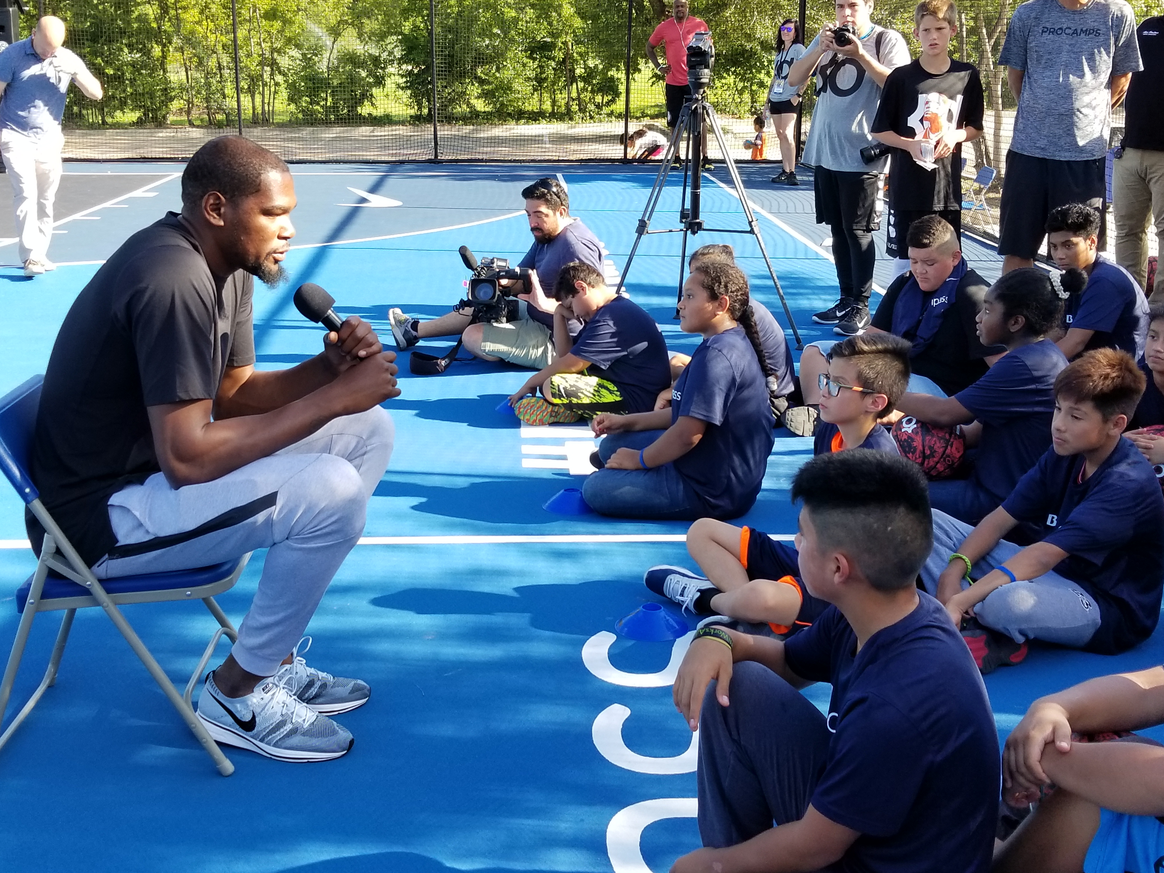 NBA All-Star Kevin Durant talks to kids at IDEA Public Schools' Austin Rundberg campus, where the bank and the Kevin Durant Charity Foundation funded a $100,000 outdoor basketball court.  (KXAN Photo/Todd Bailey)