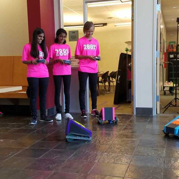 Girl Scouts play with robots_527571