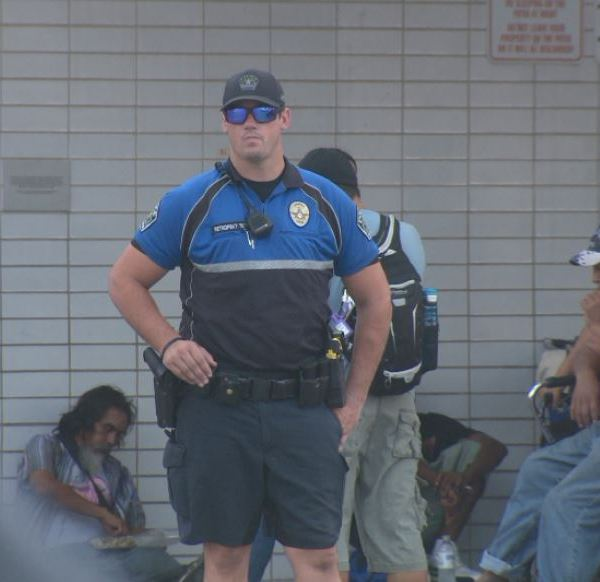 Austin police officer outside the ARCH Austin Resource Center for the Homeless_526516