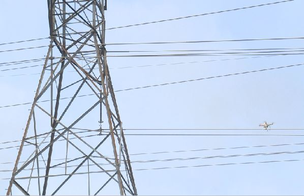 Drone inspecting power lines_357941