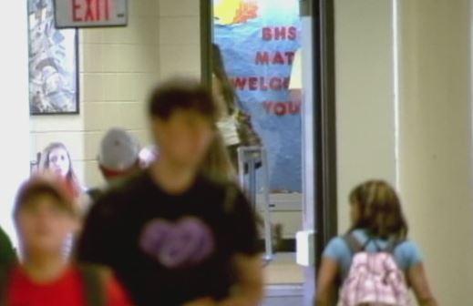Students in school hallway_528026