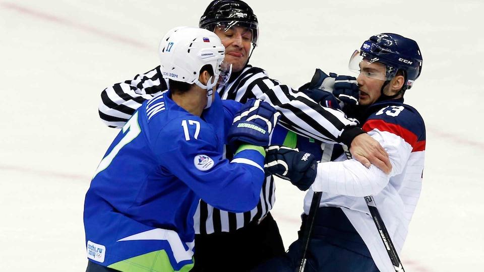 hockey-sochi-slovakia-slovenia-fight-usatsi_7740462_521651