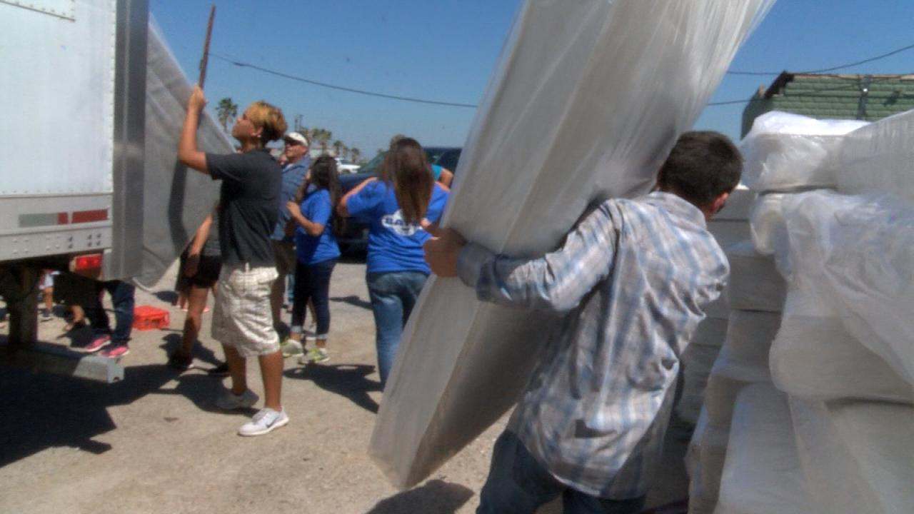 Volunteers unload donations of bedding for Harvey victims in Rockport, Texas. (Nexstar Photo/Wes Rapaport)