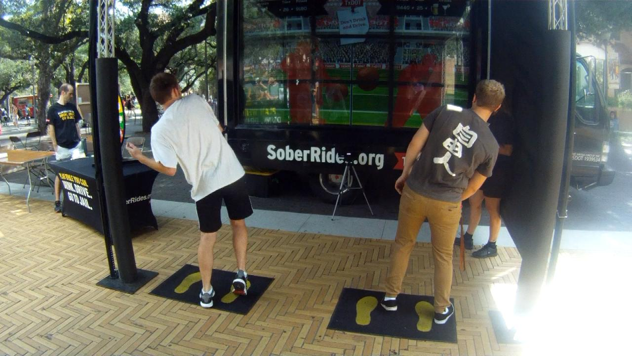 """Two UT Austin students participate in a TxDOT """"Plan While You Can"""" campaign, playing """"impaired dodgeball,"""" to learn about reaction time after drinking. Sept. 20, 2017 (Nexstar Photo/Wes Rapaport)"""