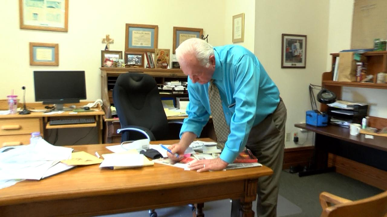 Fayette County Judge Ed Janecka writes a note in his office on Sept. 13, 2017. (Nexstar Photo/Wes Rapaport)