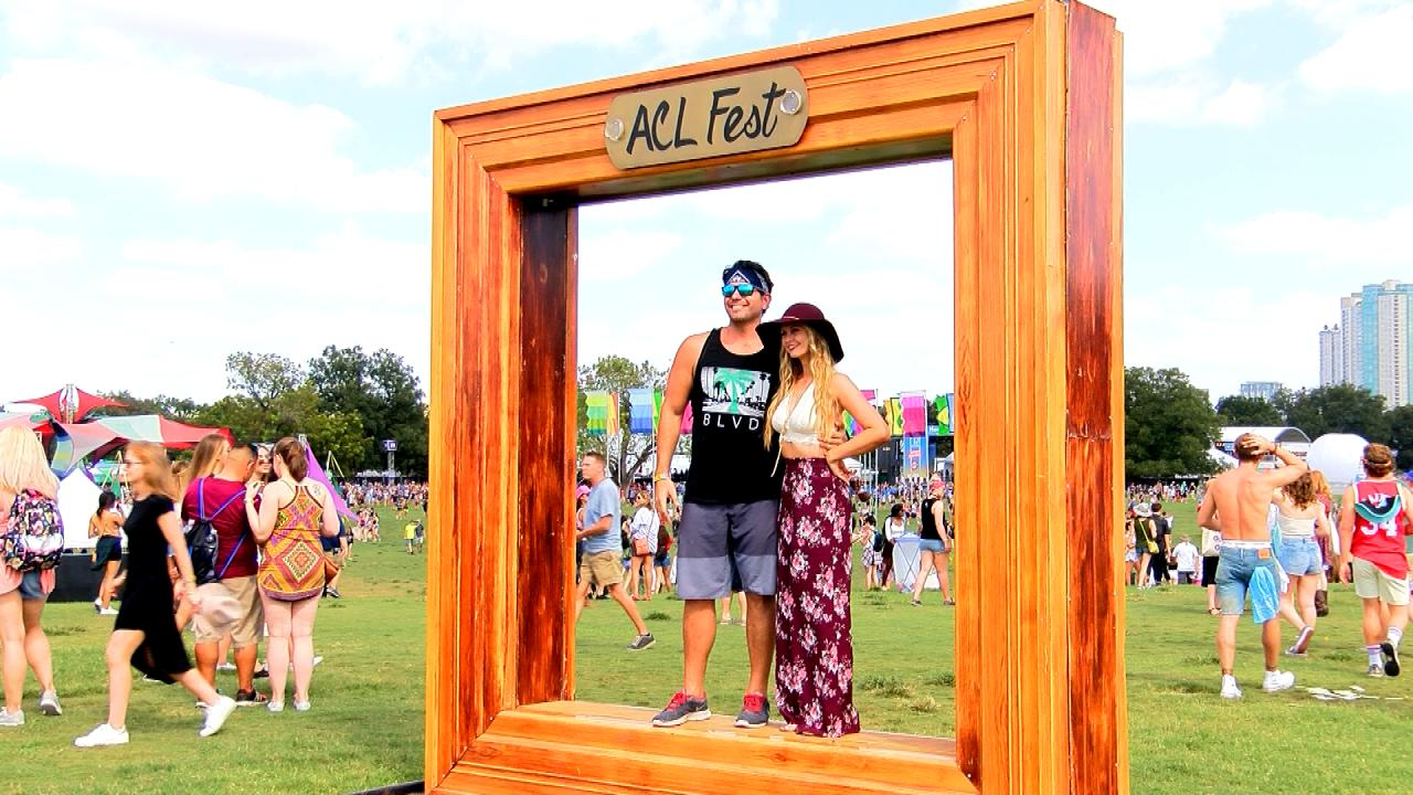 """Austin City Limits attendees pose for a photo at the """"ACL Fest"""" Frame"""" in Zilker Park on Oct. 6, 2017. (Nexstar Photo/Steffi Lee)"""