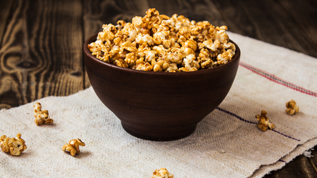 caramel popcorn in the bowl wooden background_561808