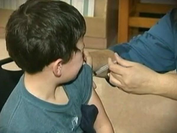 FILE - Child getting a shot immunization_555859