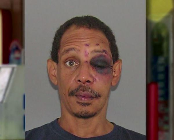Andre Young, 52, jumped over the counter while brandishing a blade._569325