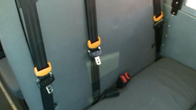 FILE - School bus seat belt_563569