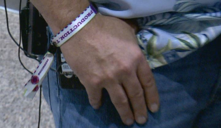 Seguin deputy police chief Bruce Ure still wears the wristband for the Las Vegas country music festival where a gunman opened fire, Oct. 4 (KXAN Photo)