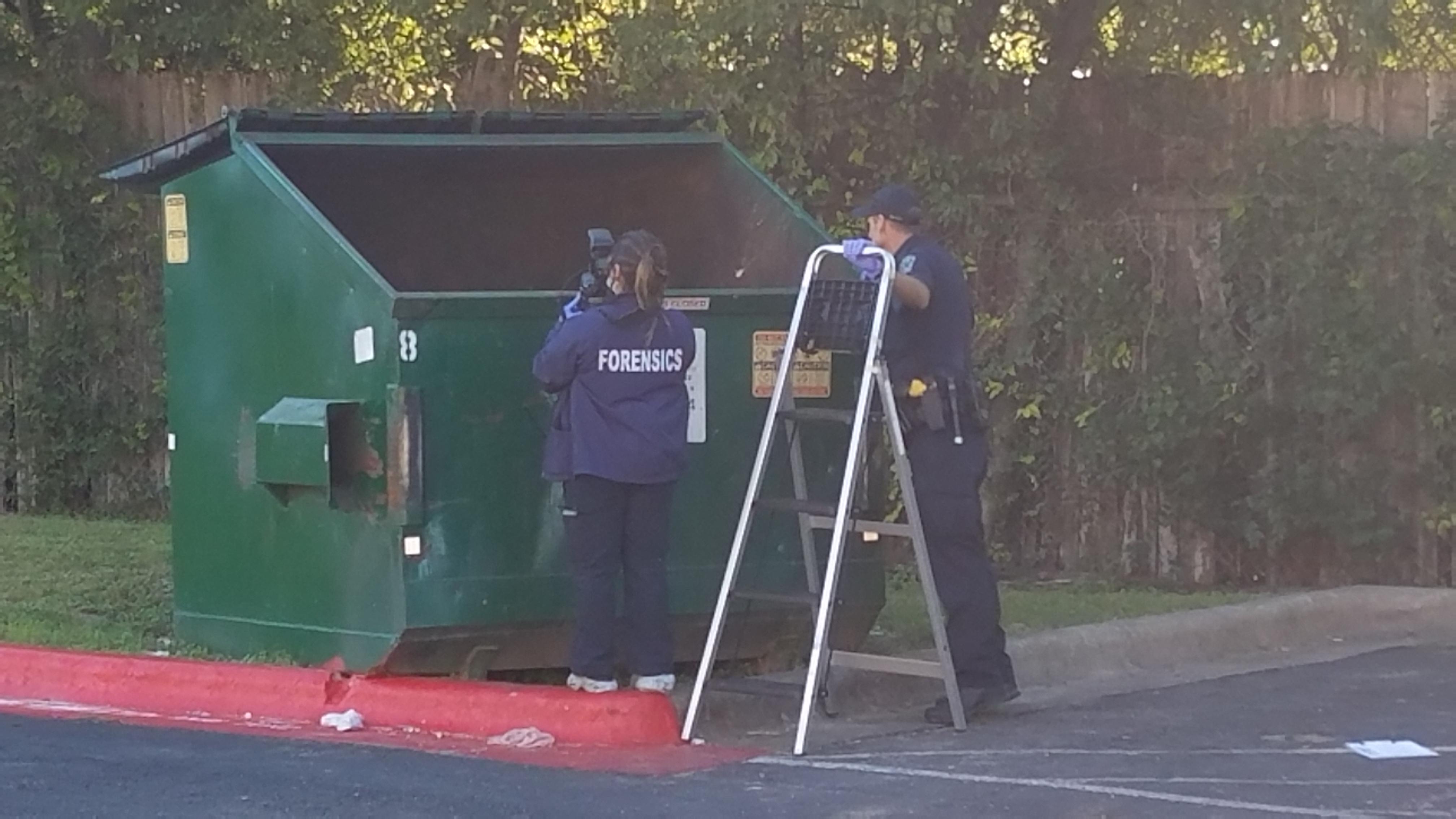 Austin police investigate a dumpster where a baby was found in North Austin (KXAN Photo/Chris Davis)