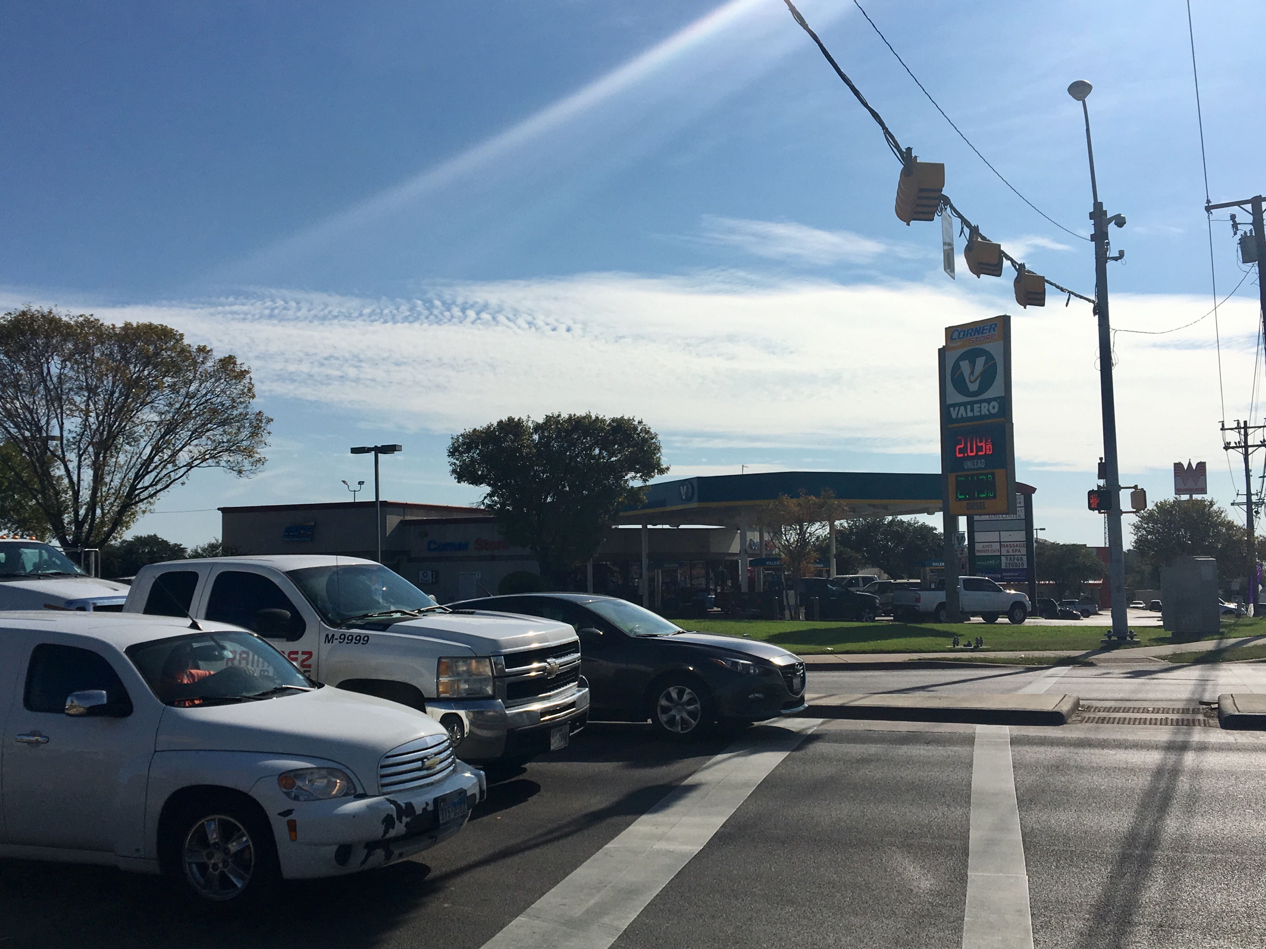 Valero gas station at I-35 and East Braker Lane where people told police a man driving a black vehicle had pointed a black, AR-style rifle at customers in the parking lot. approached him. (KXAN Photo/Kylie McGivern)