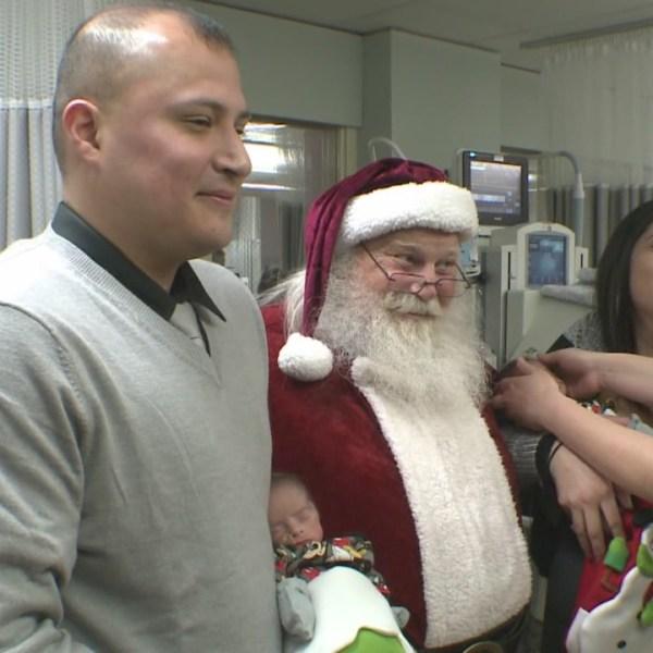 Santa visits newborns, families in NICU_599075