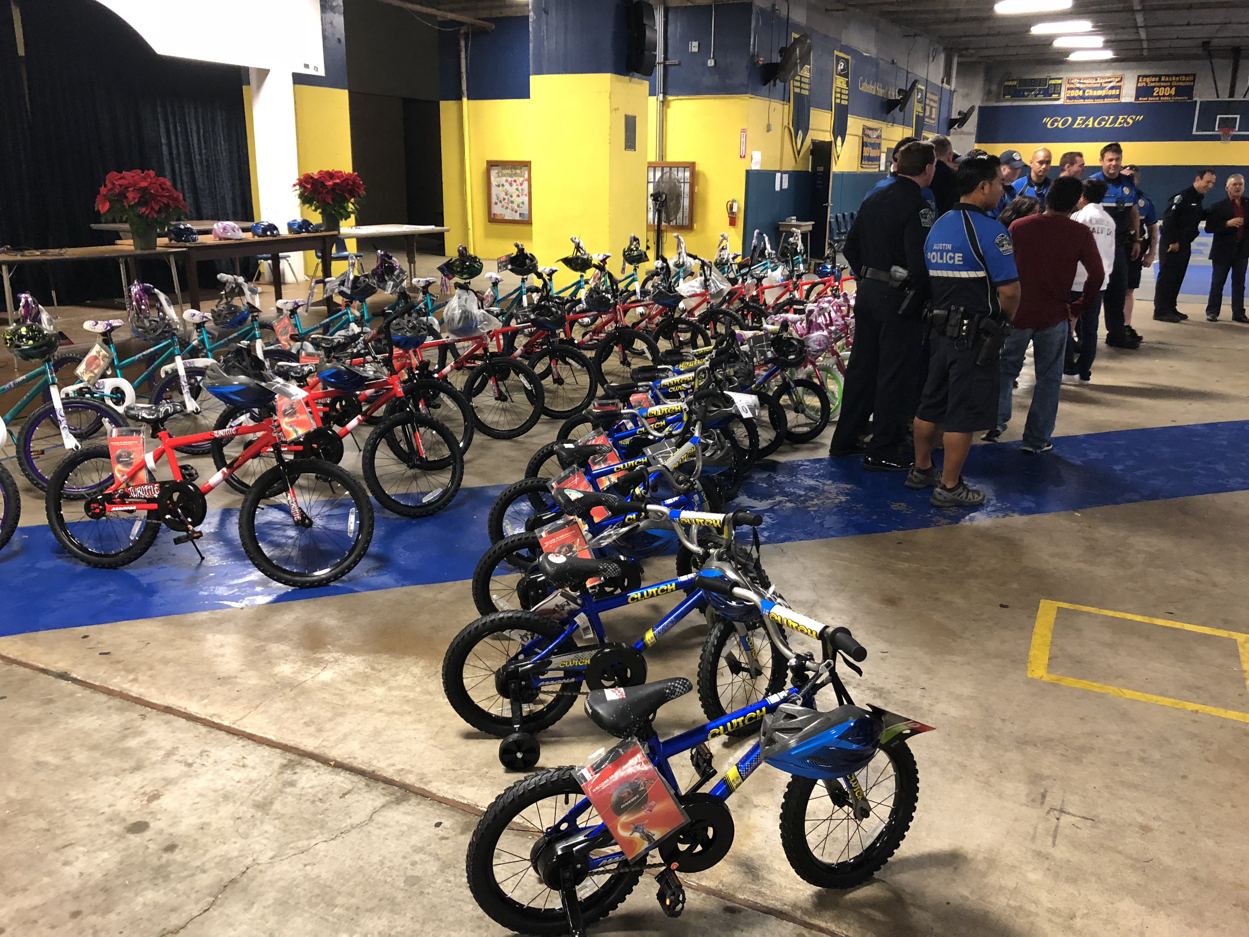 Hispanic Contractor's Association purchased bikes for children in need, and APD helped with distributing them on Dec. 22, 2017. (KXAN Photo/Julie Karam)