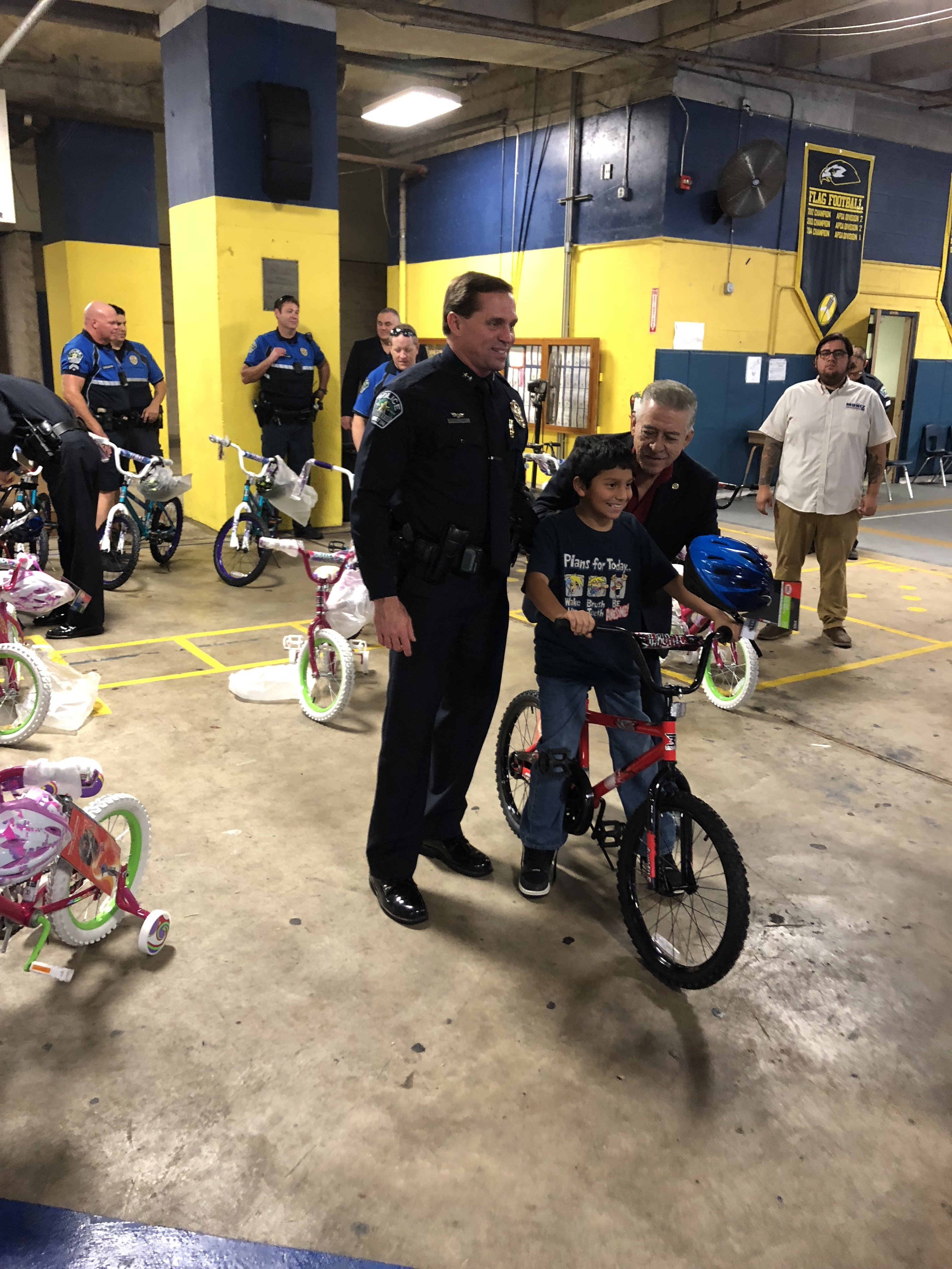 A child with their new bike courtesy of the Hispanic Contractor's Association and the Austin Police Department. (KXAN Photo/Julie Karam)