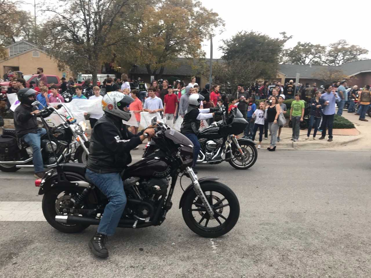 Motorcyclists delivering presents to children at Helping Hand Home_591255